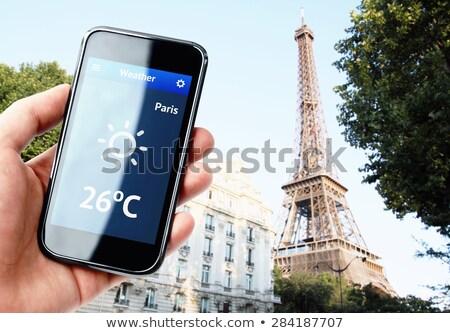 Hand smartphone weer Parijs stad Stockfoto © pab_map