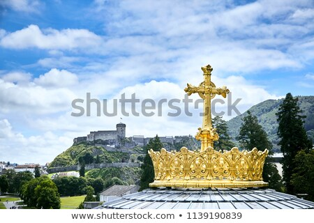 crown and cross on a dome of the basilica of our lady of the rosary of lourdes france stock photo © nejron