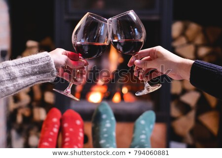 young couple sitting by open fire stock photo © monkey_business
