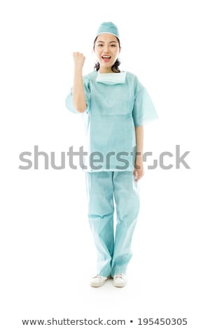 Asian female surgeon punches fist into the air isolated on colored background Stock photo © bmonteny