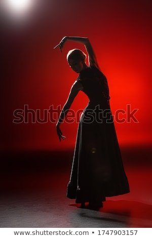 young woman dancing flamenco on black Stock photo © artjazz