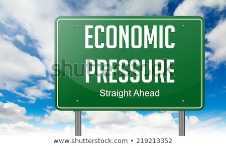 Economic Ppressure on Highway Signpost. Stock photo © tashatuvango