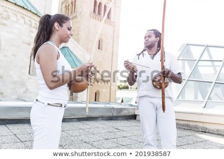 Jovem par parceria capoeira instrumento musical mãos Foto stock © Geribody