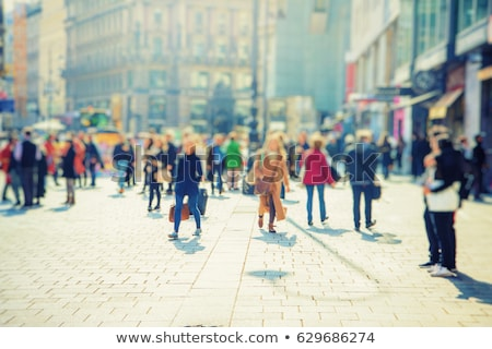 Stock photo: woman shopping in the city with town silhouette in background
