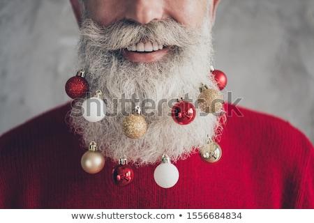 Smiling bearded christmas man Stock photo © HASLOO