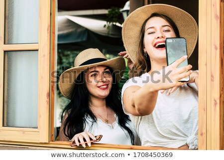 Pretty fat female takes travel selfie Stock photo © Witthaya