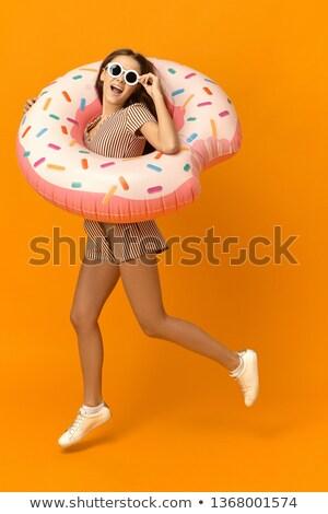 girl in inflatable pool stock photo © urchenkojulia
