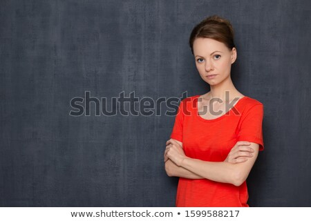 young pensive woman with arms folded isolated on a white background stock photo © deandrobot