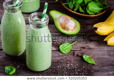 green smoothie in a bottle with fresh fruits and vegetables stock photo © zerbor