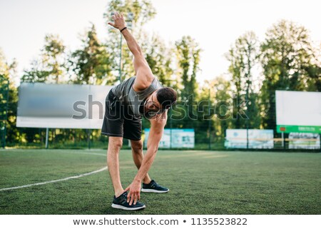 Side view of a fit young man doing stretching exercise Stock photo © wavebreak_media