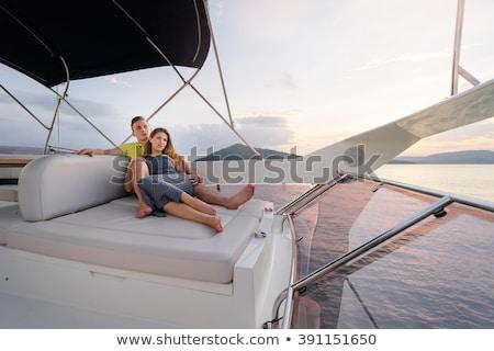 Amoroso casal veleiro beijando romântico Foto stock © Anna_Om