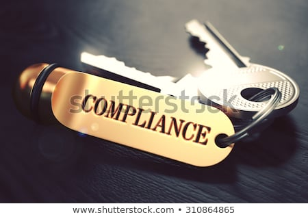 Stock photo: Keys With Word Compliance On Golden Label