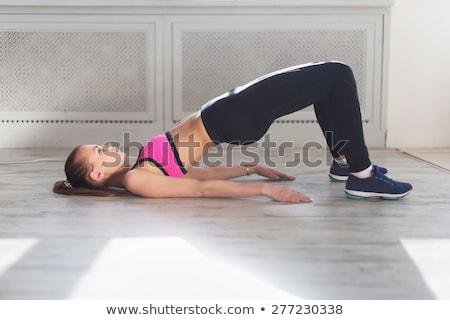 pilates woman shoulder bridge exercise workout stock photo © lunamarina