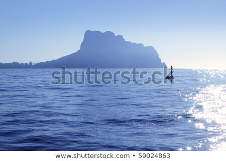 Ifach Penon mountain from Calpe blue fog backlight Stock photo © lunamarina