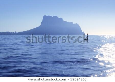montanha · azul · dente · backlight · flutuante · farol - foto stock © lunamarina