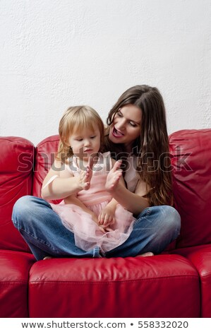 Parents play with children white leather sofa stock photo © Paha_L