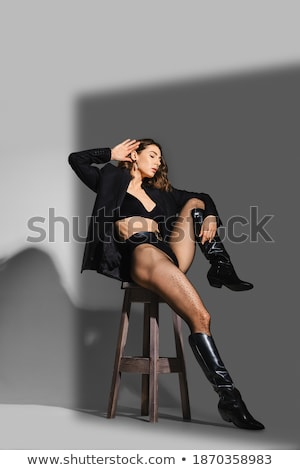 shapely female legs in pantyhose and boots Stock photo © RuslanOmega