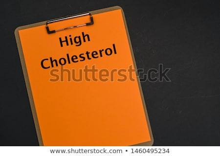 Cholesterol written on a clipboard Stock photo © Zerbor