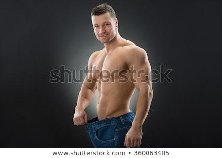Izmos férfi mutat fogyókúra visel öreg Stock fotó © AndreyPopov