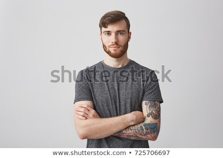 Portrait of young handsome man with gentle smile stock photo © filipw