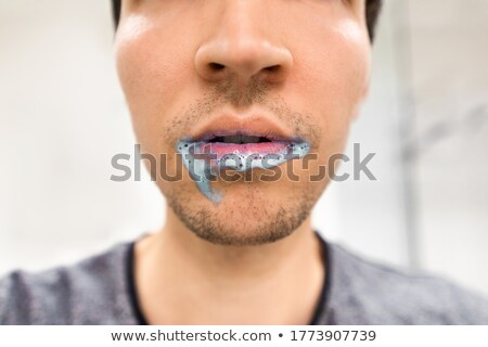 A man with a foam in his mouth Stock photo © bluering
