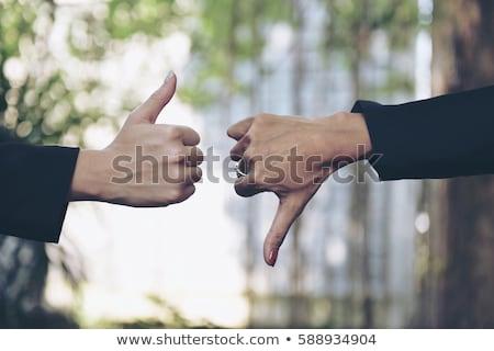 üzletember · hüvelykujjak · lefelé · felirat · kéz · férfiak - stock fotó © amaviael