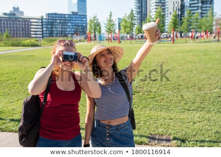 dynamic photo of a young beauty in a cup of cappuccino stock photo © konradbak