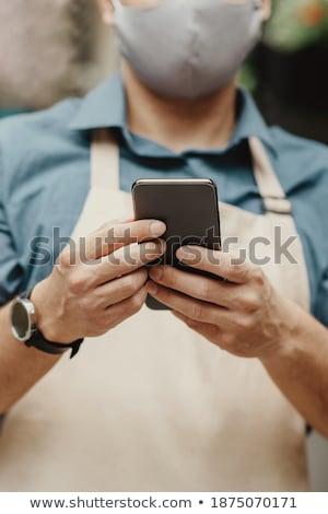 összetett · kép · kéz · tart · okostelefon · koncentrált - stock fotó © wavebreak_media