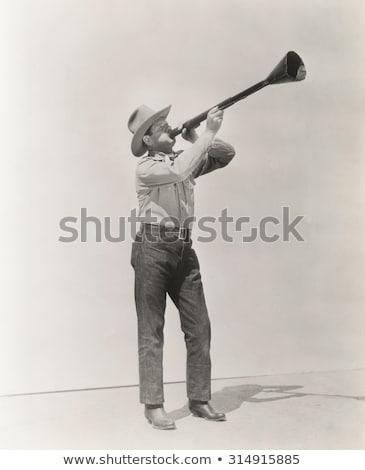 A man holding a megaphone - Wake up Stock photo © Zerbor