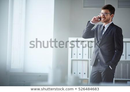 Boldog üzletember telefon telefon hívás öltöny Stock fotó © lovleah