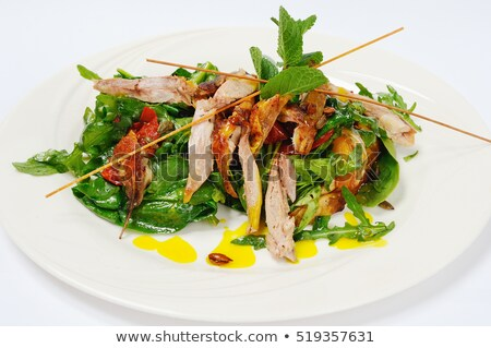 pumpkin salad with crispy duck and greens stock photo © kalinich24