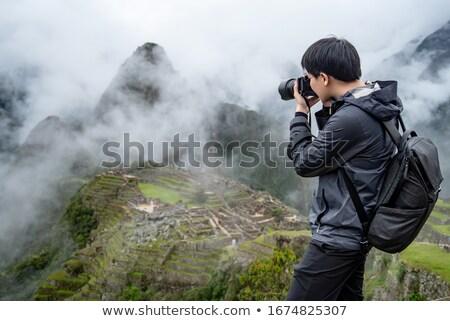 A tourist taking a photo of old archeological ruins Stock photo © zurijeta