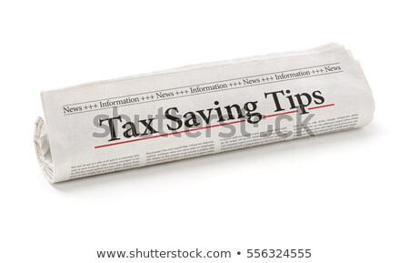 rolled newspaper with the headline tax saving tips stock photo © zerbor