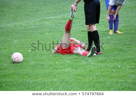 referee provides assistance injured player at the football match stock photo © smuki