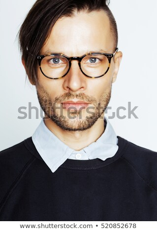 handsome middle age hipster man with modern hairstyle and tattoo beard close up on white backgroun stock photo © iordani