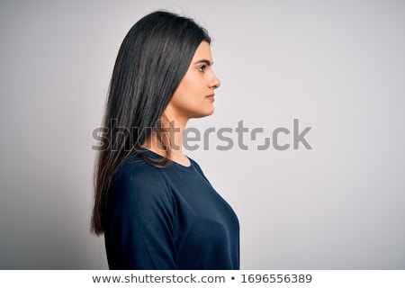 side view of a smiling attractive brunette standing and posing stock photo © deandrobot