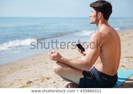 Teljes alakos póló nélkül férfi meditál tengerpart testmozgás Stock fotó © wavebreak_media