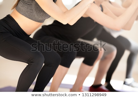 Crop view of female sportive buttocks stock photo © julenochek