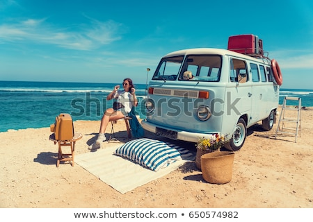 girl sitting in retro minivan Stock photo © LightFieldStudios