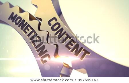 Golden Metallic Cogwheels with Content Monetizing Concept. Stock photo © tashatuvango
