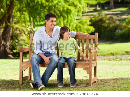 Father and son sitting outside in garden Stock photo © IS2