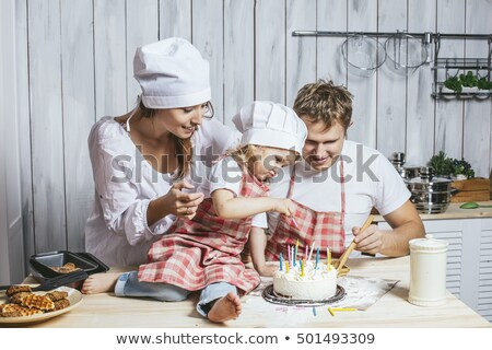 Daughter is feeding father with batter Stock photo © IS2