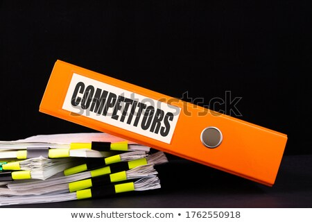 blue office folder with inscription marketing strategies stock photo © tashatuvango