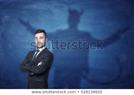 şeytan · işaret · iş · el · gülümseme · adam - stok fotoğraf © krisdog