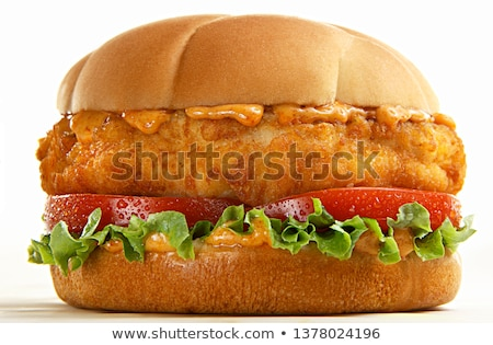 chicken burger with lettuce and tomato isolated stock photo © alexmillos