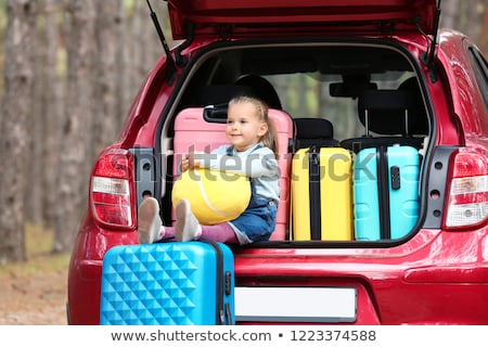 Little girl sitting on a suitcase Stock photo © IS2
