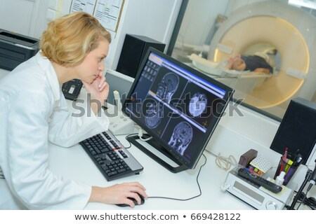 Doctors studying CAT scan Stock photo © IS2