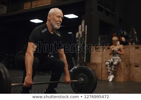 зрелый человек крест тренер улыбаясь Сток-фото © IS2