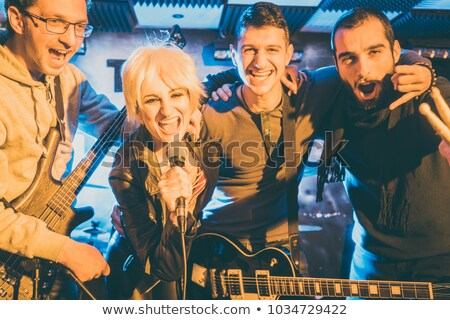 rock band on stage after successful concert stock photo © kzenon