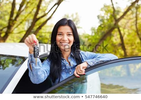 Csinos mosolyog lány tart slusszkulcs gyönyörű Stock fotó © Nobilior
